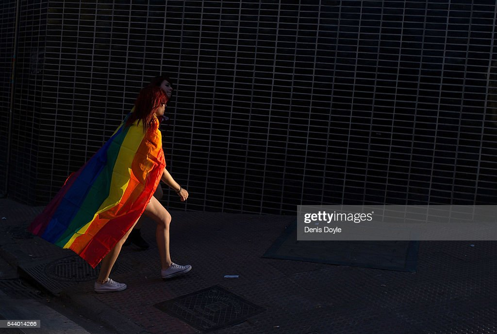 A girl wears the Rainbow flag of the LGBT Gay movement Revellers during the 2016 Madrid Gay Pride week on June 30, 2016 in Madrid, Spain. Hundreds of thousands of revellers celebrate the Gay Pride week in Madrid, one of the biggest in Europe.