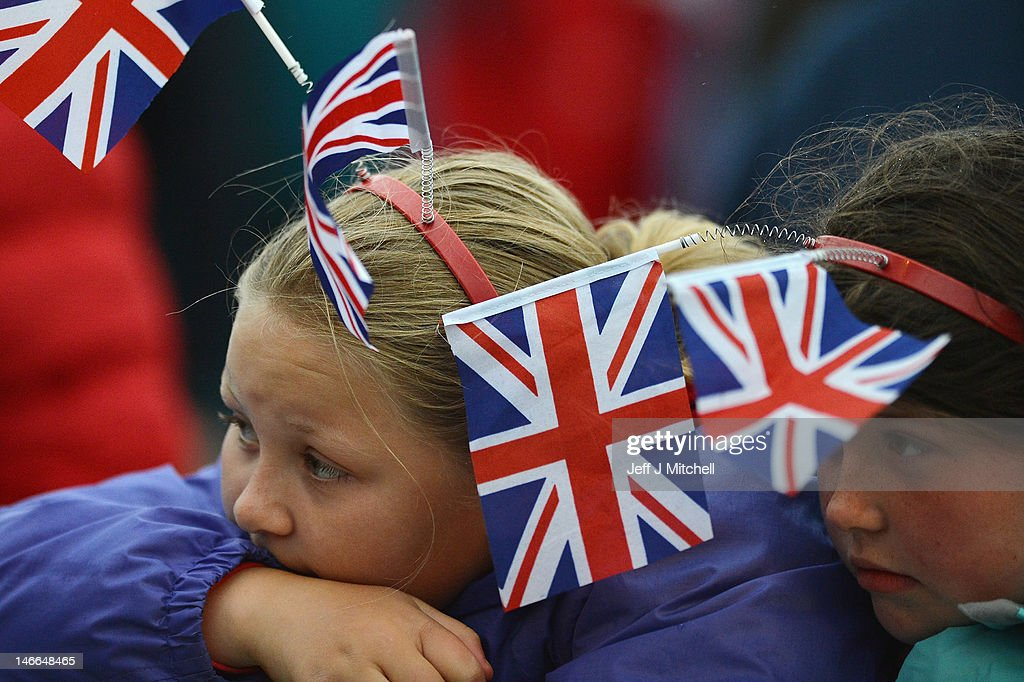 A girl wears the union jack flag while watching Maestro Gustavo Dudamel conduct the children from the Big Noise Orchestra during the Big Concert on June 21, 2012 in Stirling, Scotland. The Big Concert is the opening event of the London 2012 festival. The special outdoor event set against the backdrop of Stirling Castle, features a full performance by lead by conductor Gustavo Dudamel and the Simon Bolivar Orchestra of Venezuela.