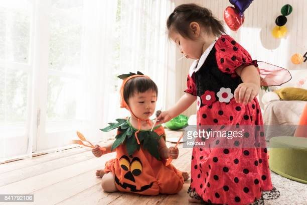 A girl who gives candy to a boy.