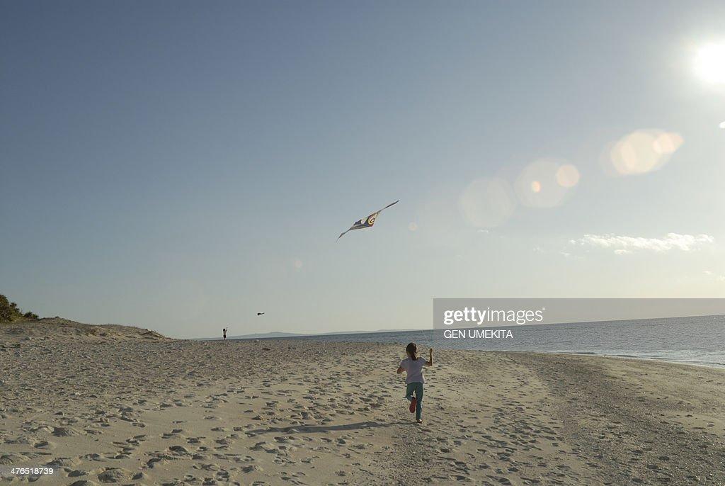 A girl who play on the beach