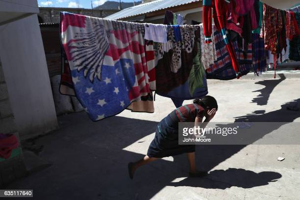 A girl who's father works as as immigrant laborer in the US plays outside her home built with money sent back from the United States to Cajola on...