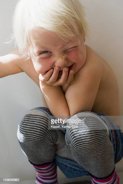 Girl winking and laughing