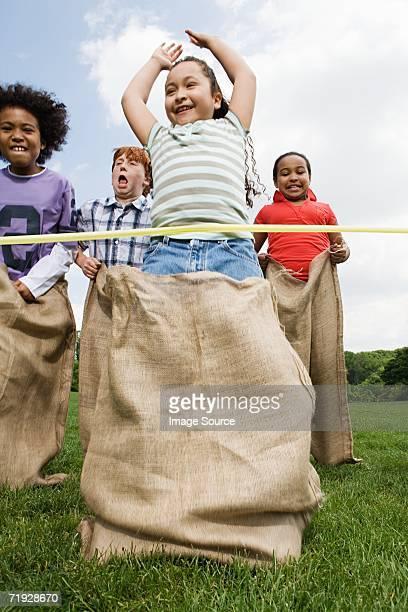 Girl winning sack race