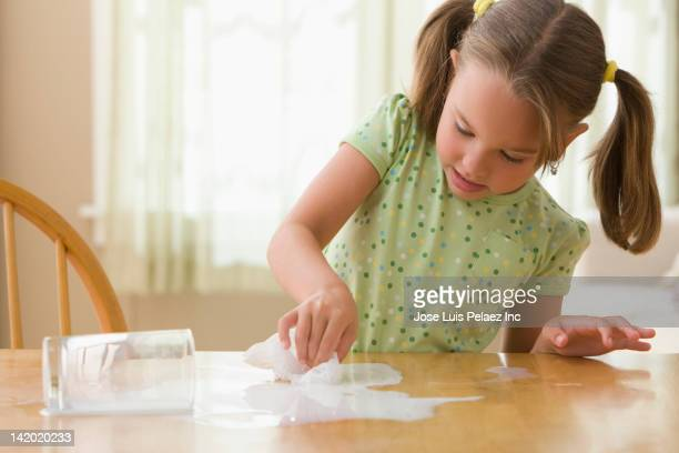 Girl wiping up spilled milk