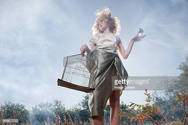 Girl with a bird and cage