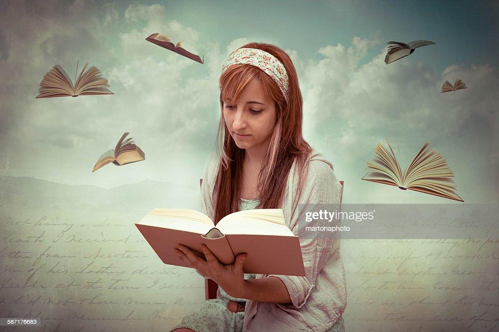 Girl with a book in hands : Foto de stock