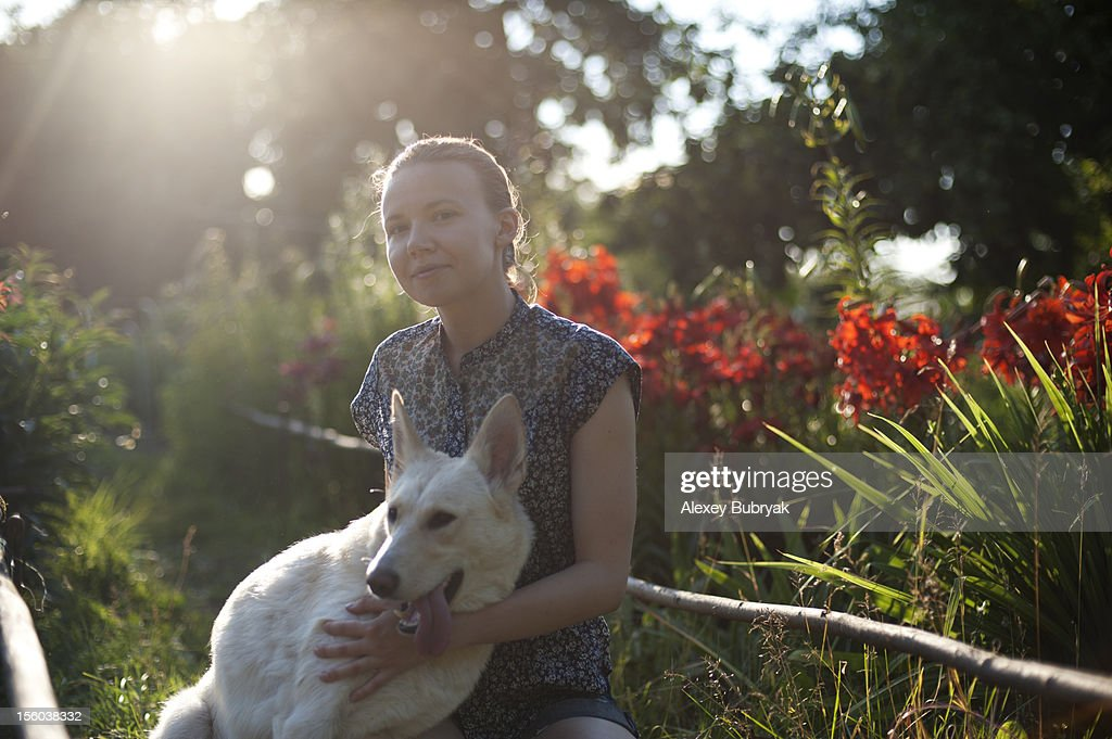 Girl with a dog outdoors : Stock Photo