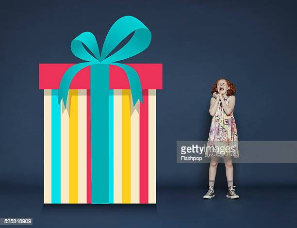 Girl with a giant cartoon gift