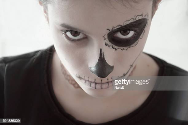 Girl with a painted face for Halloween