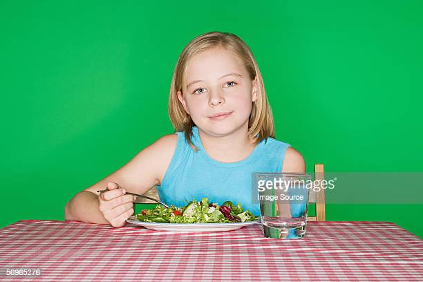 Girl with a plate of salad