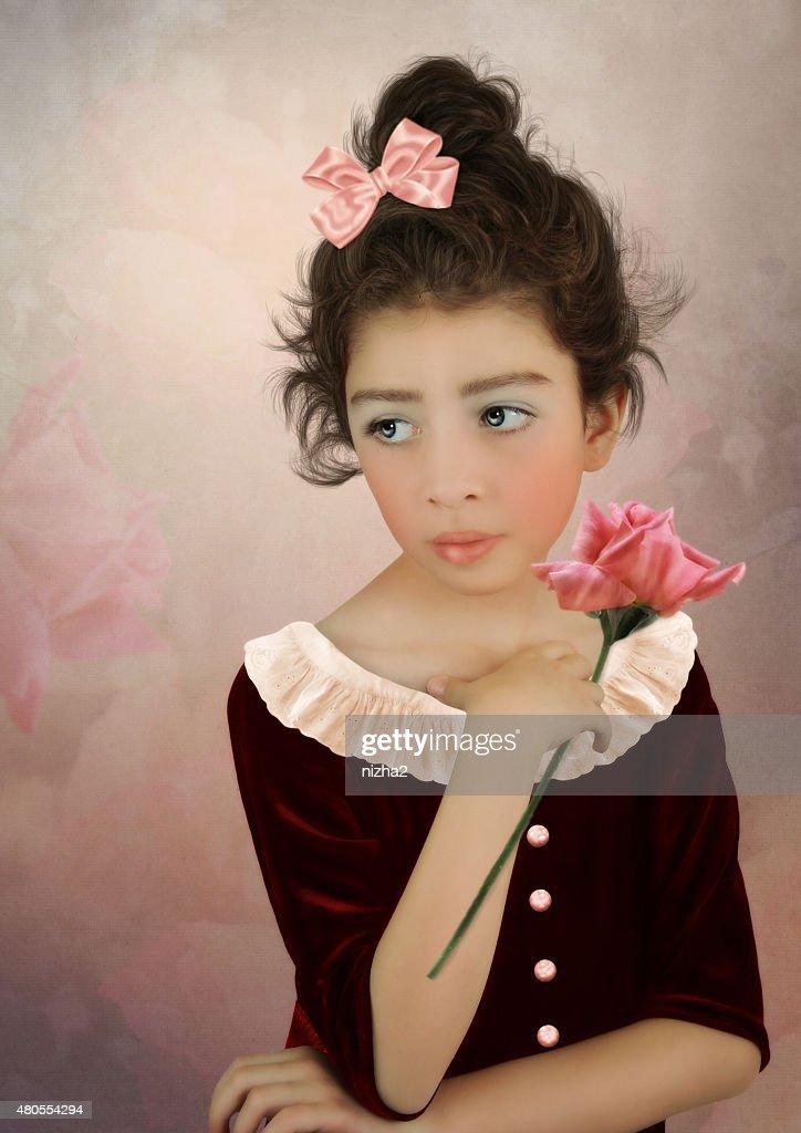 Menina com uma rosa : Foto de stock