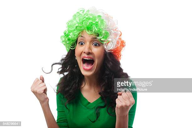 Girl with a wig cheering