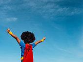 Girl with afro playing superhero