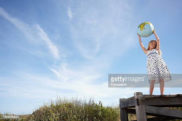 Girl with an earth model