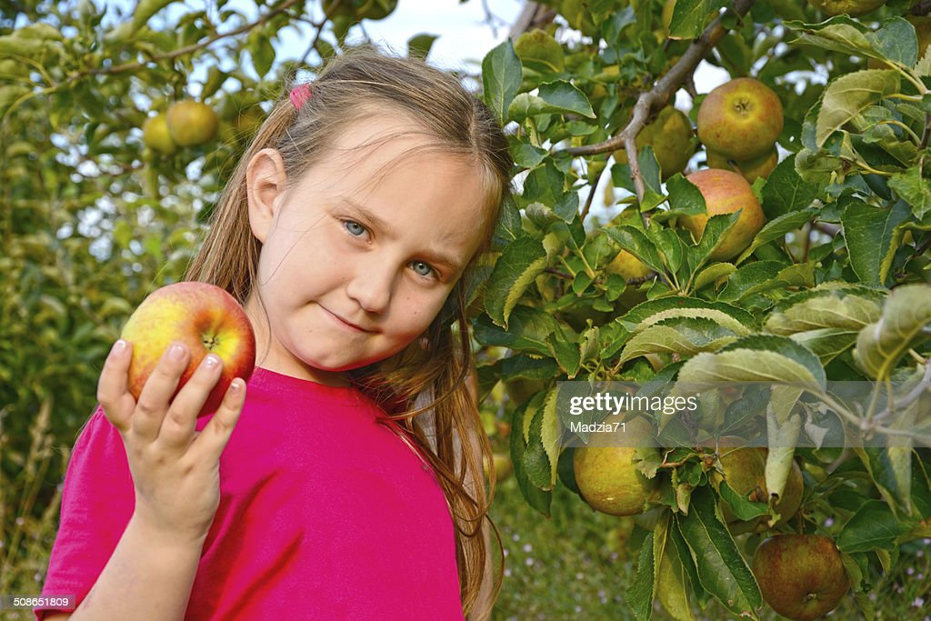 Girl with apples : Stock Photo