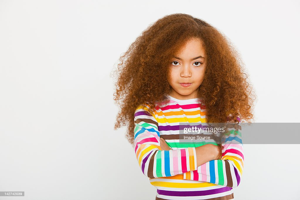 Girl with arms crossed : Stock Photo