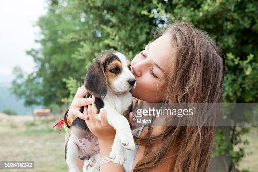 Girl with baby dog