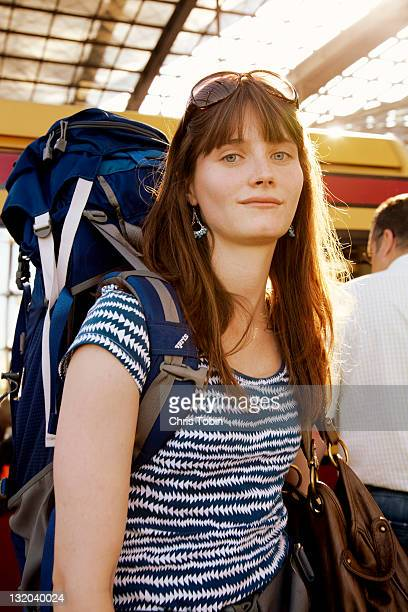 Girl with backpack in train station