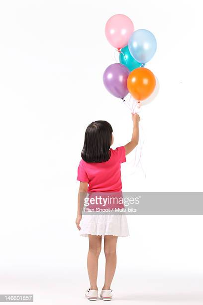 Girl with ballons, rear view