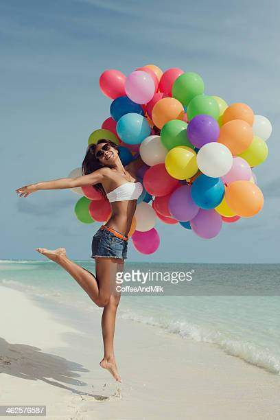 Girl with balloons at the beach