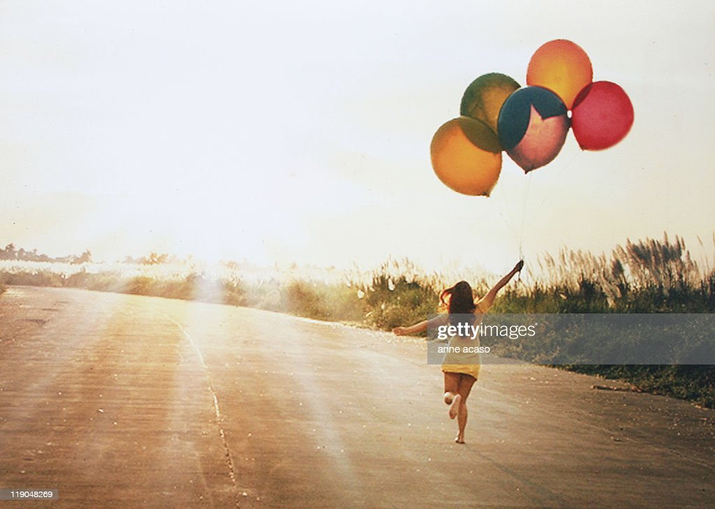Girl with balloons : Stock Photo