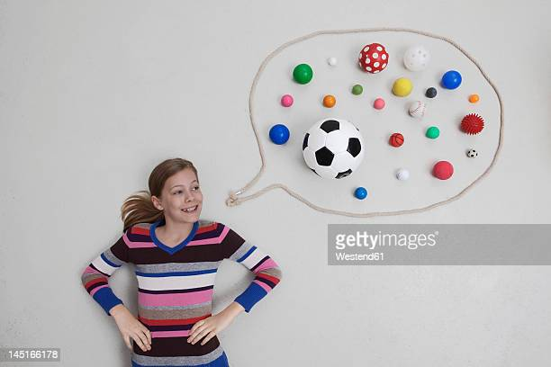 Girl with balls in speech bubble