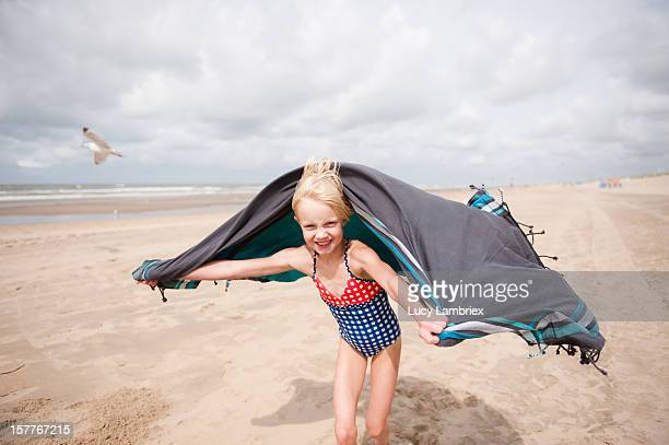 Girl with beach towel and seagull