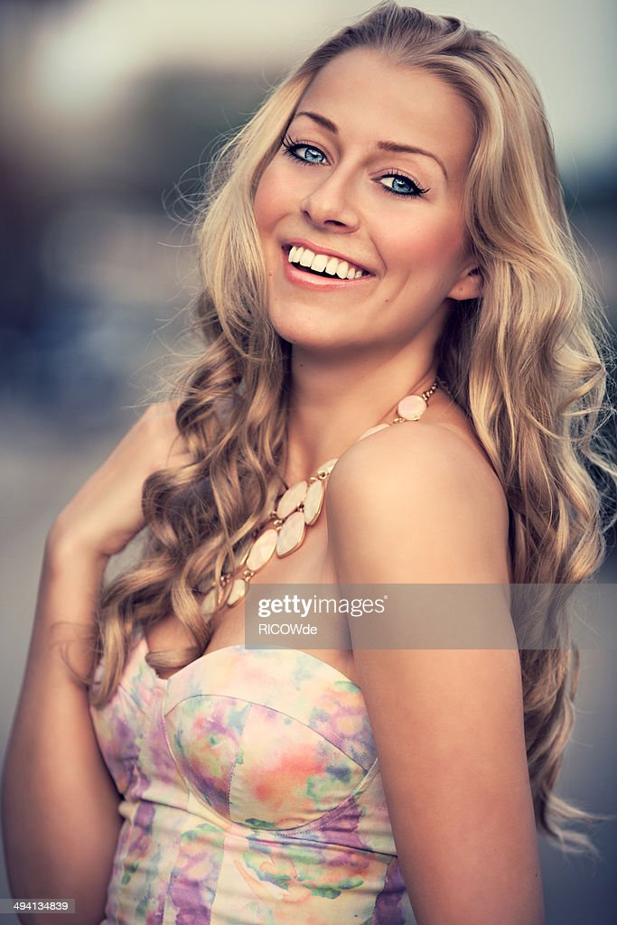 Girl with beautiful smile in depth of field