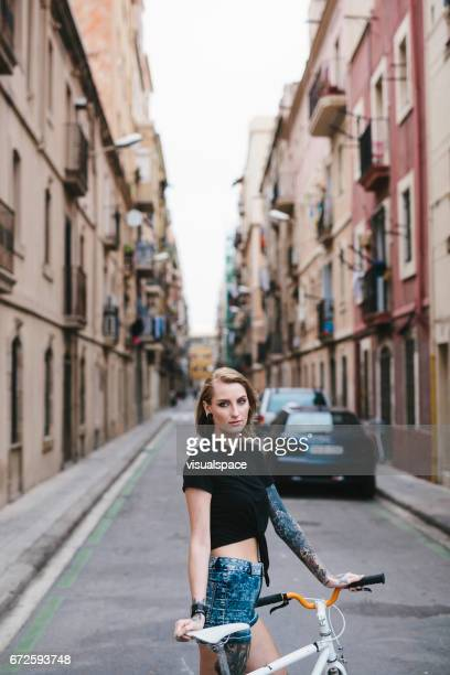 Girl with Bicycle in a Spanish Alley-Way