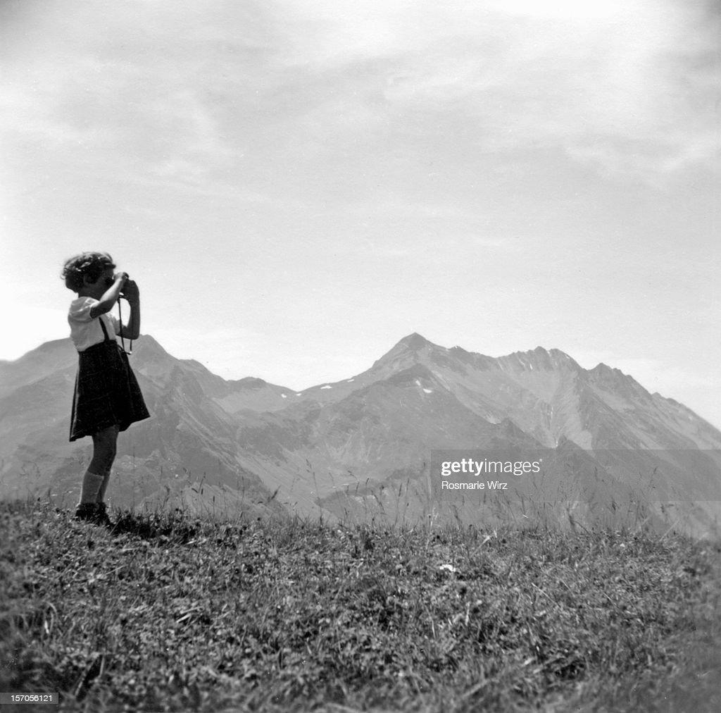 Girl with binoculars : Stock Photo