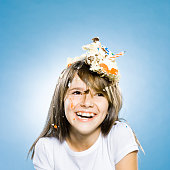 girl with birthday cake on her head