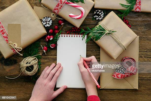 Girl with blank note pad and Christmas gifts