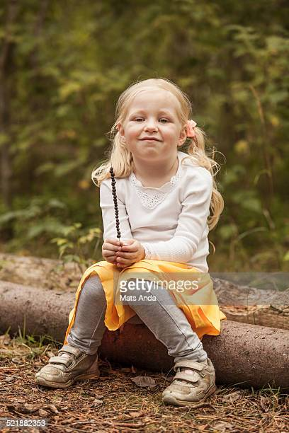 Girl with blueberries on a straw