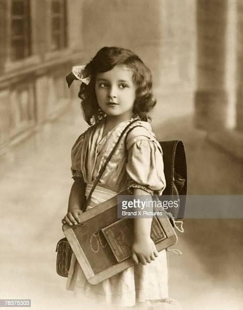 Girl with book and slate