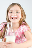Girl with bottle of milk