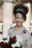 Girl (13-15) with bouquet at Quinceanera, portrait