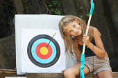 Happy girl with bow and sports aim