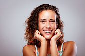 Portait of a smiling young woman showing her perfect white teeth with braces. Looking at camera.