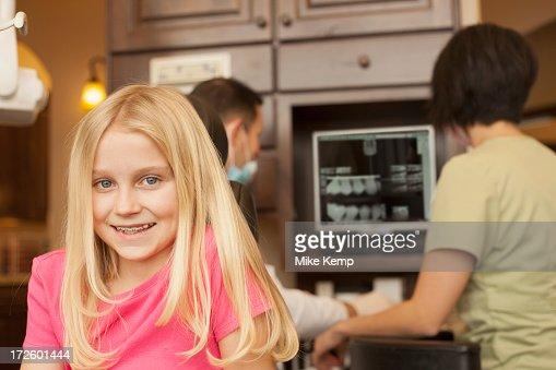 Girl with braces smiling in dentist's office : Bildbanksbilder