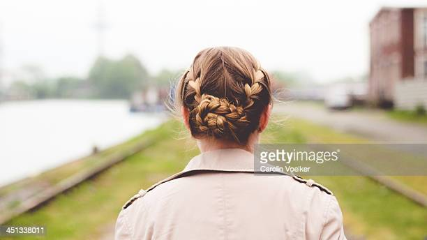 Girl with braids photographed from behind