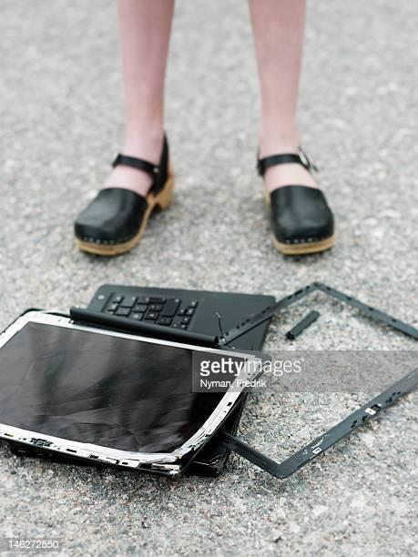 Girl with broken laptop