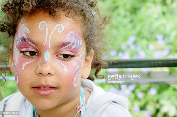 Girl (6-7) With Butterfly Face Paint, Portrait