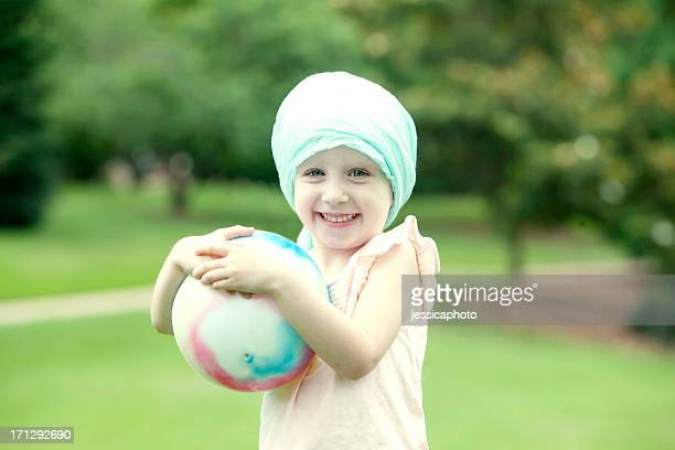 Girl with Cancer Playing in the Park