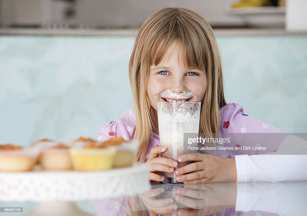 Girl with chocolate milkshake and cream