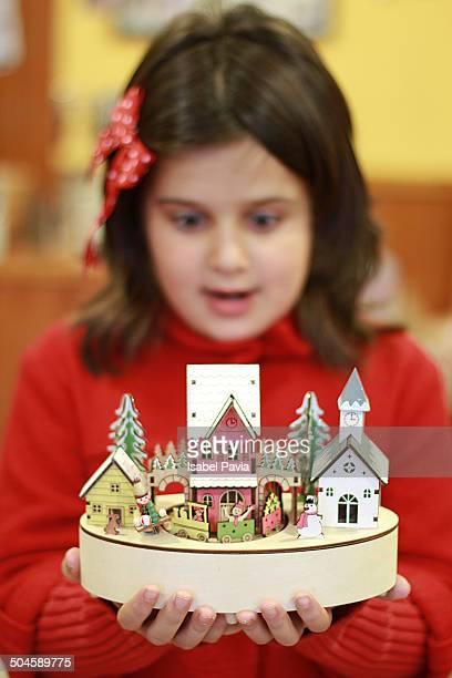 Girl with Christmas music box