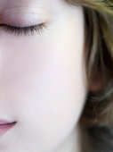 Girl (16-17) with closed eyes, close-up