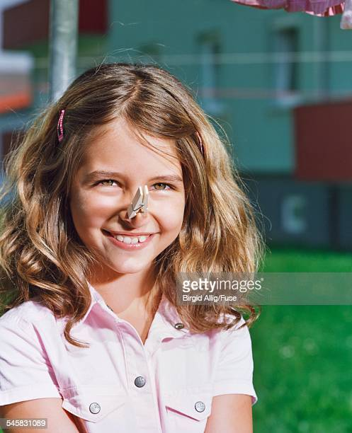 Girl with Clothespin on Her Nose