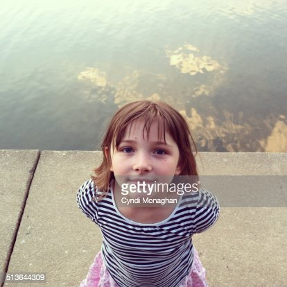 Girl with clouds reflected on water