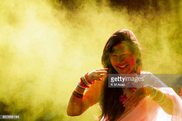 UNIVERCITY DHAKA BANGLADESH A girl with color powder attend celebrate the Holi Festival or Festival of Colors after smearing each other with colored...