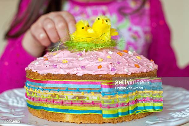 Girl with colourful Easter cake